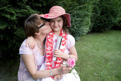 Mother kissing daughter Stock Photo