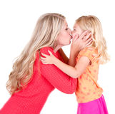Mother kissing daughter Royalty Free Stock Images