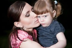 Mother Kissing Daughter Stock Images