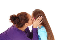 Mother kissing daughter. Royalty Free Stock Photo