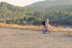 Mother Kissing Girl Royalty Free Stock Image
