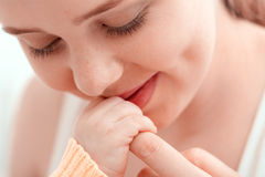Mother kissing hands of her baby. Gentle kiss. Mother kissing hand of her baby with love Royalty Free Stock Photos