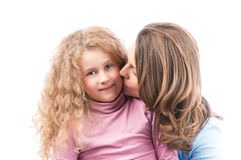 Mother kissing happy little daughter. Royalty Free Stock Photo