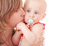 Mother kissing her baby Royalty Free Stock Photos