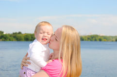 Mother kissing her baby Royalty Free Stock Image