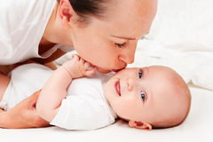 Mother kissing her baby Royalty Free Stock Photography