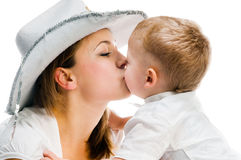 Mother kissing her baby. Mother kissing son on a white background Stock Photography