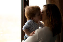 Mother kissing her baby boy son Royalty Free Stock Photo