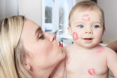 Mother kissing her baby, close up portraits Stock Images