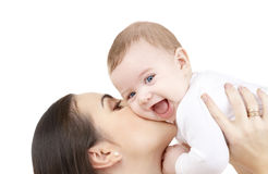 Mother kissing her baby. Family and happy people concept - mother kissing her baby Stock Image