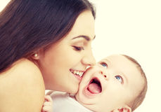 Mother kissing her baby. Family and happy people concept - mother kissing her baby Royalty Free Stock Photos
