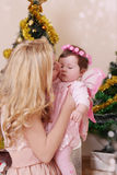 Mother kissing her baby girl Royalty Free Stock Image
