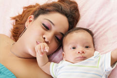 Mother kissing her baby hand. Royalty Free Stock Photos