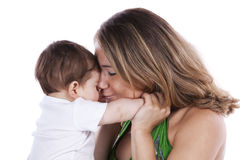 Mother kissing her baby son Royalty Free Stock Photography