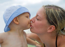 Mother kissing her child. Young mother kissing her little child Royalty Free Stock Photos