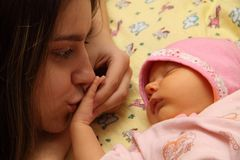 Mother kissing her child. Mother kissing her small child Stock Photos