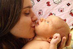 Mother kissing her child Stock Photo