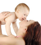 Mother kissing her child. Isolated over white royalty free stock photo