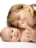 Mother kissing her child's hand royalty free stock photo