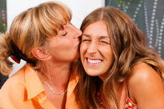Mother is kissing her daughter Royalty Free Stock Photo