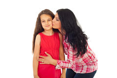 Mother kissing her daughter Royalty Free Stock Images