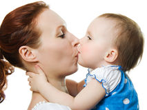 Mother kissing her daughter Royalty Free Stock Image