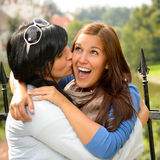Mother kissing her daughter happy embrace outdoors Royalty Free Stock Photo