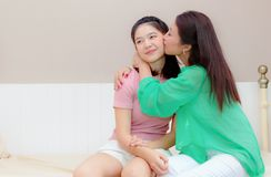 Mother is kissing her daughter. Happy family Royalty Free Stock Image