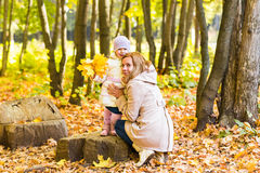 Mother kissing her daughter in the park.  Woman Royalty Free Stock Image