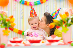 Mother kissing her happy baby Royalty Free Stock Images