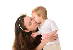 Mother kissing her little son. Isolated on white background royalty free stock photos