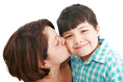 Mother kissing her son. Adorable mother kissing her beautiful son isolated on white background Stock Images
