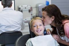 Mother kissing her son while dental examination Stock Image