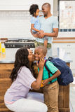 Mother kissing her son going to school. In the kitchen Royalty Free Stock Photo