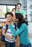 Mother kissing her son. In the kitchen Stock Photography