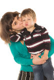 Mother kissing her son. On a white background Royalty Free Stock Images
