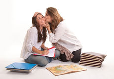 Mother kissing her teen daughter Stock Image