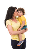 Mother kissing her toddler son. Isolated on white background Stock Photography