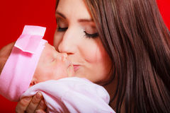 Mother kissing and holding little newborn baby Royalty Free Stock Photography