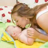 Mother kissing newborn baby Stock Photo