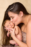 Mother kissing newborn baby Stock Photography