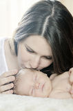 Mother kissing newborn baby Royalty Free Stock Photography
