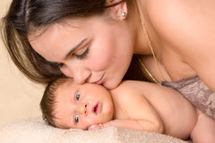 Mother kissing newborn Royalty Free Stock Photography