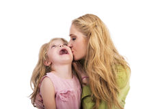 Mother kissing and playing with her lovely daughter. Over white  background Royalty Free Stock Images