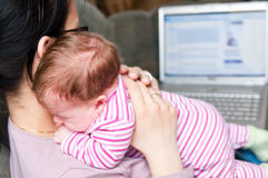 Mother with laptop and baby Royalty Free Stock Photography