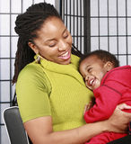 Mother with laughing baby. Mother hugging her happy baby