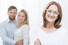 Mother-in-law and family. Smiling mother-in-law with happy family in background Royalty Free Stock Photo