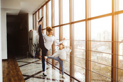 Mother learning daughter to make a high leg strech Royalty Free Stock Photography