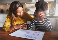 Mother learning her daughter to calculate Royalty Free Stock Photo