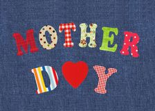 Mother- lettering of handmade paper letters over jeans backgroun Stock Photography